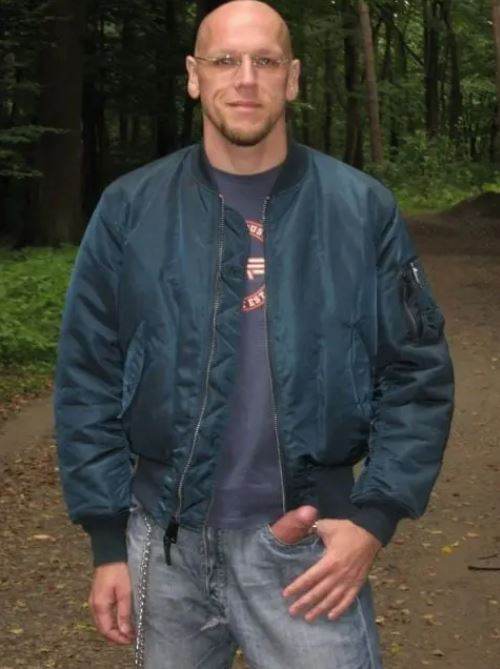 this picture shows a male showing his giant dong going up through his jeans to his left side pocket
